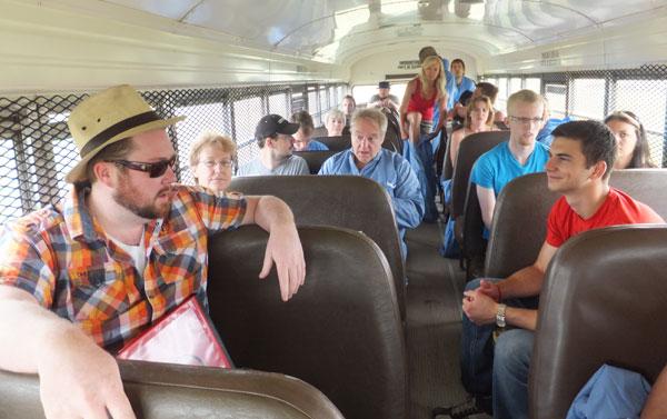 Director Scott Belyea talking to actors on bus